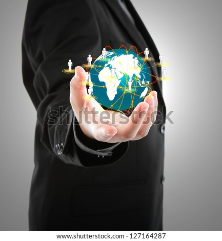 Business man holding the small world in his hands