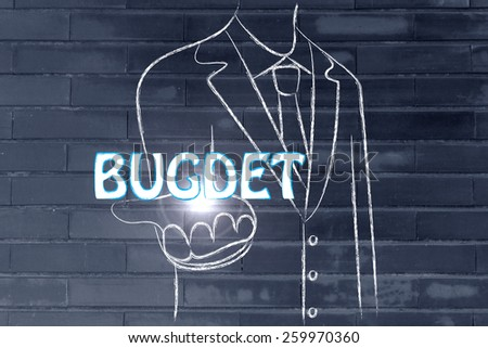 business man holding the word Budget - stock photo