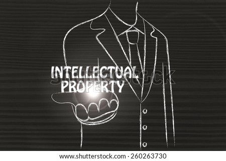 business man holding the word Intellectual Property - stock photo