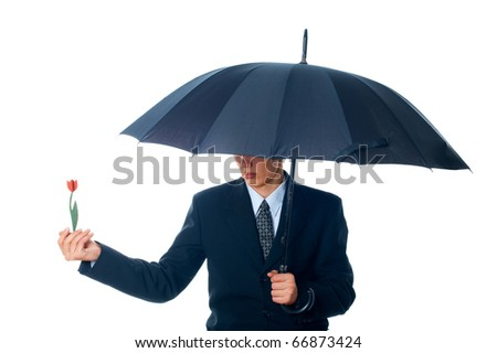 business man holding umbrella with flower - stock photo