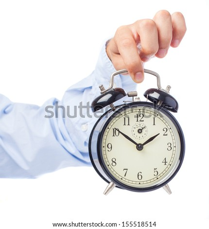 business man holding vintage alarm clock on white