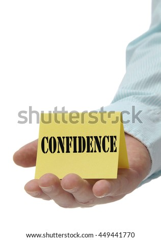Business man holding yellow confidence sign on hand - stock photo