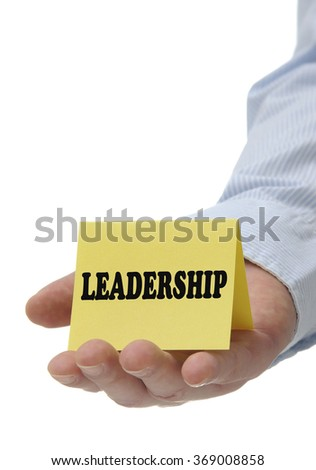 Business man holding yellow leadership sign on hand - stock photo