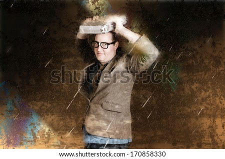 Business man in a bad weather storm of rain and danger hiding under a briefcase from impeding disaster. Financial crisis concept - stock photo