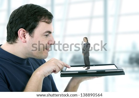 Business man in a holographic image - stock photo