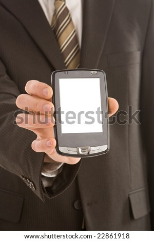 Business man in a suit holding a pda - stock photo