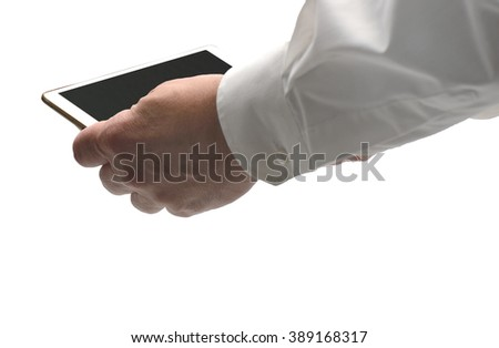 Business Man in a white Shirt holding a Touch Screen with a black surface