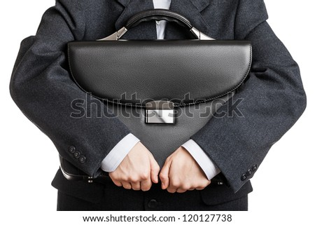 Business man in black suit hand holding briefcase - stock photo