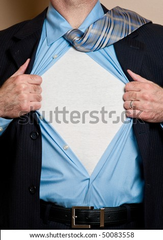 Business man in dark blue suit opens shirt to reveal blank white undershirt. Blank area suitable for your logo or text.