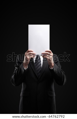 Business man in dark suit holding a blank sign - stock photo
