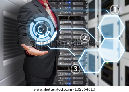 Business man in data center room - stock photo