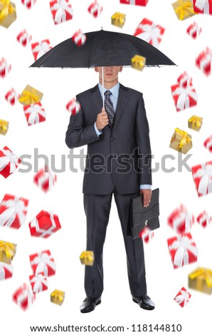 Business man in elegant modern suit hold an umbrella rain of gift box present fly fall down around, isolated over white background, concept of holiday - stock photo