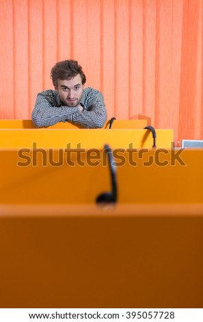 Business man in empty start up company, bussinesman at the end of table row, copyspace - stock photo