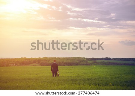 Business man in field - stock photo