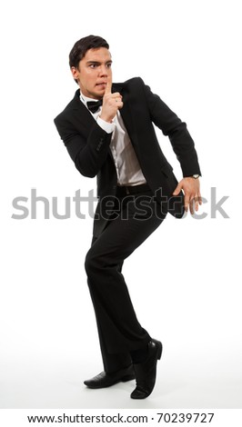 Business man in formal clothes showing a shh gesture calling for silence - stock photo