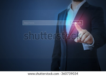 business man in formal wear searching something in internet - stock photo
