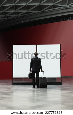business man in front of the sign board during a business travel, choice concept - stock photo