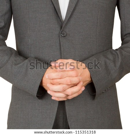 Business man in grey suit praying, isolated - stock photo