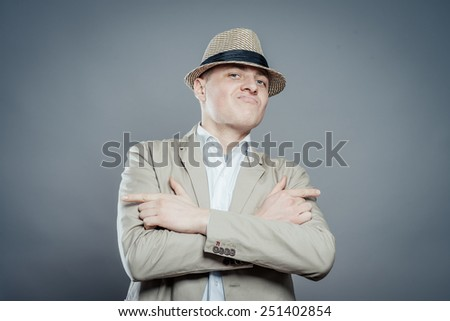 business man in hat hand of show gun  isolated - stock photo