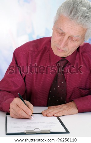 business man in maroon shirt sits on a isolate