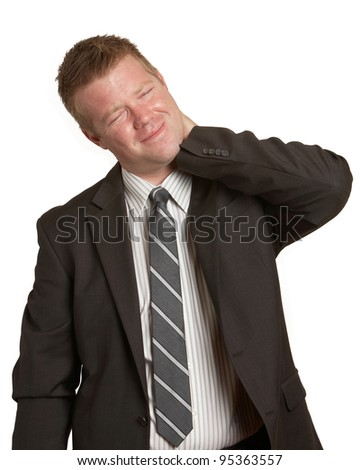 Business man in pain with neck injury white background - stock photo