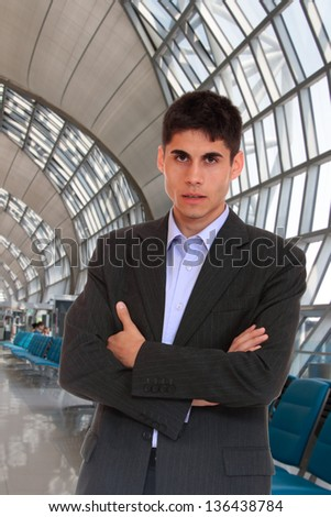 Business man in suit at the airport - stock photo