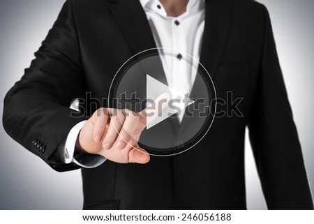 Business man in  suit pressing on virtual button - stock photo