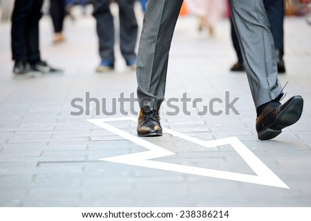Business man in suit taking a big fast step forward, arrow - stock photo
