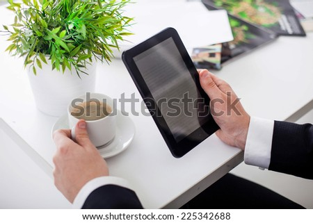 business man in the office shows Tablet - stock photo
