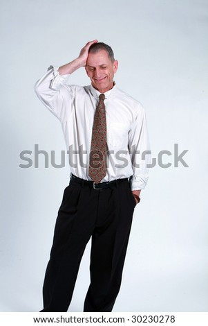 business man in tie holding head