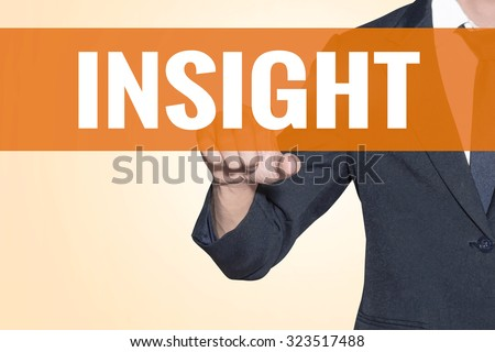 Business man Insight word touch on virtual screen orange background - stock photo