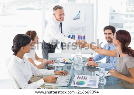 Business man introducing new employee to the company - stock photo