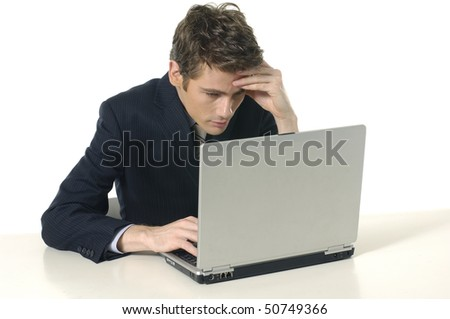 business man is frustrated on a table with a laptop - stock photo