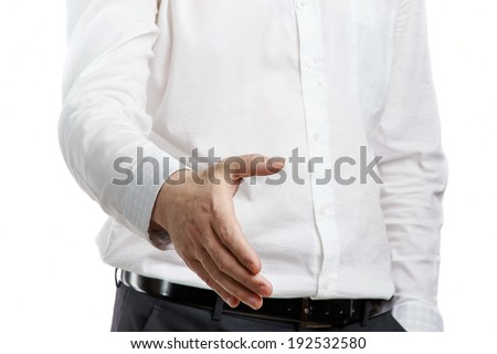 Business man is giving a handshake , closeup on the hand - stock photo