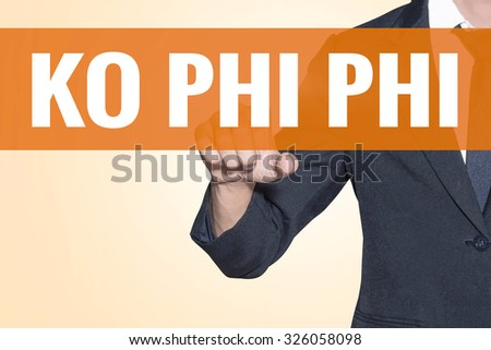 Business man Ko Phi Phi word touch on virtual screen orange background - stock photo
