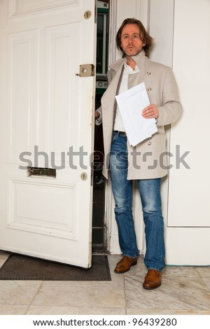 Business man long hair entering office - stock photo