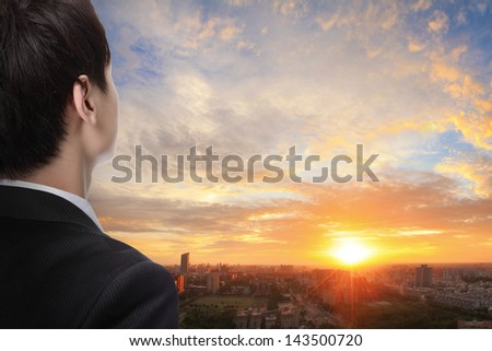 business man look sunrise in the city, concept for business - stock photo