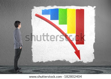 Business man looking and analysis business down graph / risk management concept - stock photo