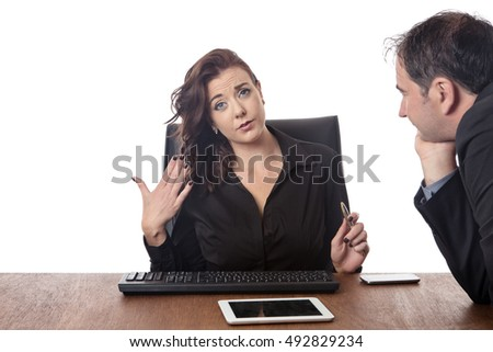 business man looking at a female work colleague boobs