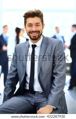business man looking at camera - stock photo