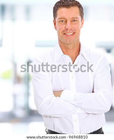 business man looking at camera in the office with copy space - stock photo