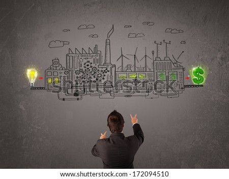 Business man looking at factory that makes money from ideas concept - stock photo