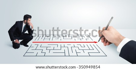 Business man looking at hand drawing solution for maze solution concept - stock photo