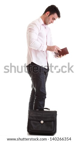 Business man looking at his empty wallet. Isolated on a white background - stock photo