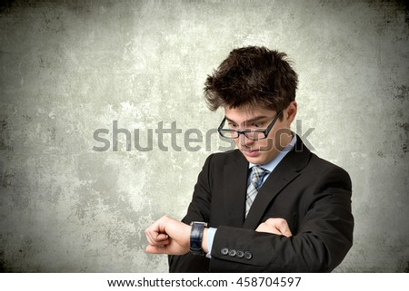 Business man looking at his watch