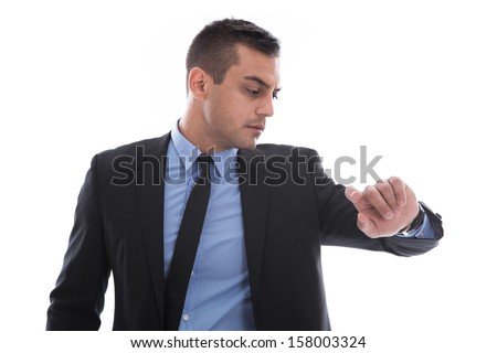 Business man looking at his watch. In a rush. Isolated on white background - stock photo