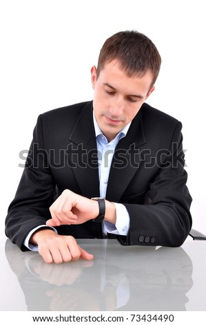 business man looking at his watch over white