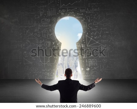 Business man looking at keyhole with bright cityscape concept background - stock photo