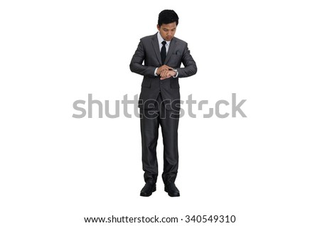 Business man looking at watch on his arm.