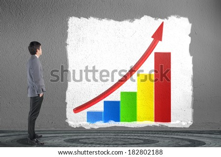 Business man looking business graph - stock photo